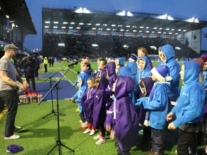 Children premiere song during Pompey match