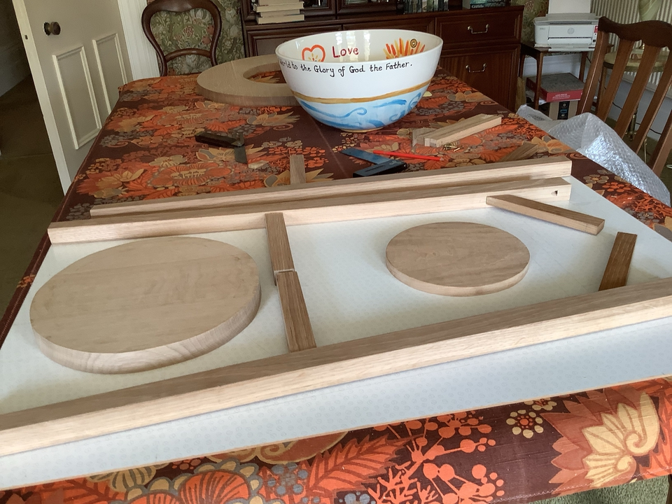 The pieces of the font stand before they are assembled, with the bowl decorated using a pupil's design