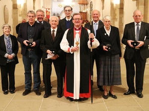 Bishop honours faithful worshippers with award