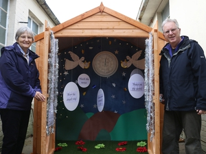 Life-size Advent calendar inside a shed