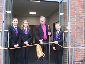 Bishop opens school building named after him
